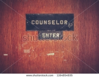 stock-photo-retro-grungy-counselor-s-office-door-at-a-public-school-or-university-1164854935
